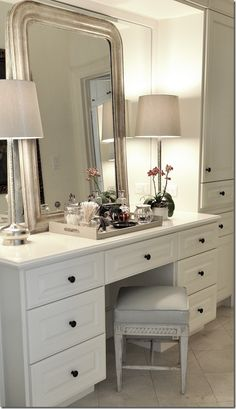 she added a leaning Louis Philippe mirror against the mirror, along with contemporary lamps and an antique bench. Again – another great idea to take home – you don't have to pull out a mirror – just layer an antique one against it.