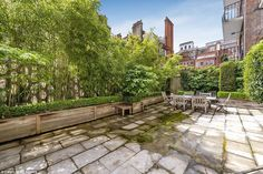 Dining al fresco: The terrace of the ground floor flat, pictured, has lots of potential an...