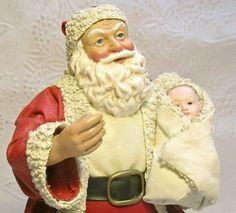 Christmas Ornament Santa holding a newborn baby 6 inches tall Paper Mache