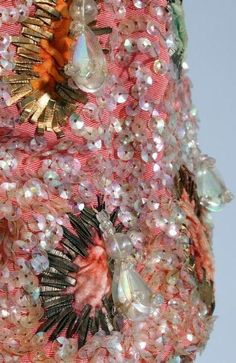 Schiaparelli couture and Lesage embroidered salmon-pink faille bolero jacket, c 1948 heavily embellished with pearlised sequins Tambour Embroidery, Couture Embroidery, François Lesage, Elsa Schiaparelli, Italian Fashion Designers, Textiles, Bolero Jacket, Paisley, Fabric Manipulation