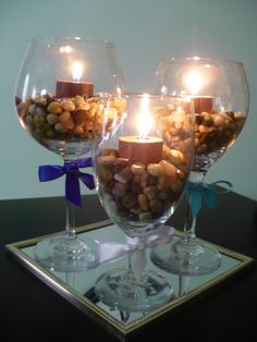 Wine Bottle Centerpieces with Lights | Fill glasses with rocks, stones, pebbles, or marbles and candles, tie ...
