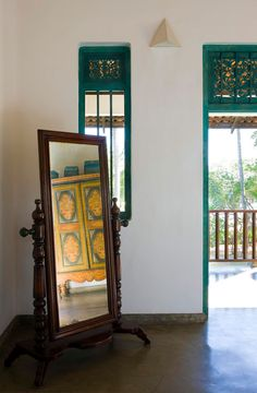 Antique colonial furnishings and traditional wood carvings lend the villa a distinctly Sri Lankan vibe. #Indistay | The Last House, Sri Lanka