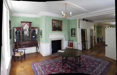 The drawing room on the first floor (2nd floor for Americans.) The white doors in the middle are an ingenious device to partition this floor in a number of ways. It can be opened up to a room off to the right, or create two completely separate rooms on either side of the staircase that comes up in the middle.