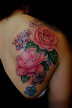 floral back tattoo by Mallory Johnstone -  This piece consists of Alyssums, Camillias, and Forget-me-not flowers. It took around 12 hours total.