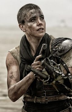 Charlize Theron is FIERCE as  the renegade Imperator Furiosa in 'Mad Max: Fury Road.'