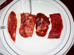 Four cuts of Iberico pork--pluma, secreto, presa and ??? raw, Sierra Mayor, Consorcio de Jabugo, Jabugo (Huelva).  Photo by Gerry Dawes copyright 2005 / gerrydawes@aol.com.