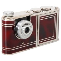 Vintage 1956 camera with make-up kit. Working camera makes 14x14 exposures and holds powder and lipstick- a must for glam spies! Vanity Camera designed Walter Kunik for Petie.