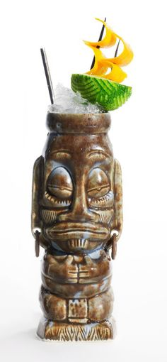 tiki mug garnish. Love this! It's a sailboat.