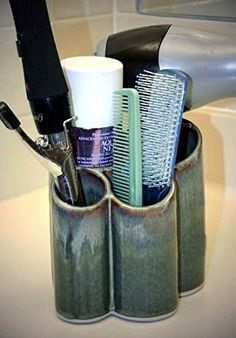 Bay Pottery Hairdryer Holder in Jade.       FUNCTIONAL ART holds your hairdryer and styling accessories OR pens and other items on your desktop     HANDCRAFTED IN THE USA of high-fired reduction porcelain. Measures 5.75 x 5.5 x 6.25 inches     LEAD-FREE colorfast glazes     STURDY and DURABLE dishwasher safe     PLEASE NOTE handcrafted glazes will vary in color so each piece will be unique