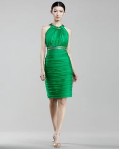 This Carmen Marc Valvo cocktail dress is stunning, drawing attention to the halter neckline and showing off the shoulders.  This is a lovely dress for a semiformal or formal wedding.