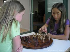 girls playing chess NAMC Montessori Inspired Age Appropriate Toys 6-9