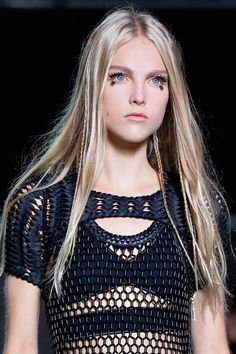The hippy doll-like beauty was achieved at Louis Vuitton with an exaggerated lash look and miniature plaits woven into the models' long locks. Channel this come festival season.   - Cosmopolitan.co.uk