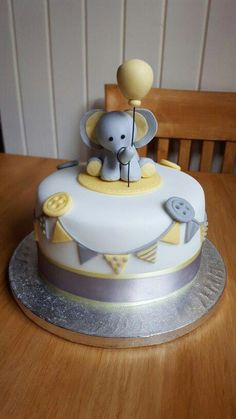 A baby shower party can be completed without the existence a baby shower cake whether is in a special or just simple design. The existence of baby shower cake Baby Shower Cakes Neutral, Elephant Baby Shower Cake, Elephant Cakes, Baby Shower Yellow, Baby Shower Cakes For Boys, Elephant Theme, Baby Shower Themes, Baby Boy Shower, Baby Shower Decorations