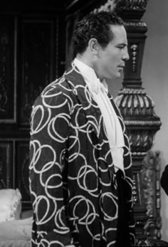 Former World Heavyweight Boxing Champion Max Baer in a fantastic dressing robe, in 'Over She Goes' (1937)