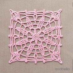 Crochet lace motifs in pink and