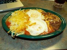 Huevos Rancheros, also known as ranch eggs, are a traditional Mexican-Spanish breakfast, consisting of fried eggs, chile, refried beans, sliced avocado, fried potatoes, olives, and chili peppers, served on a fried corn tortilla.    Huevos Rancheros was traditionally served to farm workers who usually had a small meal at dawn later followed with a large mid morning breakfast.    Huevos Rancheros (Ranch-style Eggs)    Yield: 3-6 servings                      Cooking Time: 10 minutes    1…