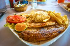 Fish Casado - tilapia, rice, french fries, plantain at Palomo Restaurant  Grande de Orosi River