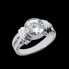 3 carat diamond solitaire ring, bezel setting in white gold...sparkly!
