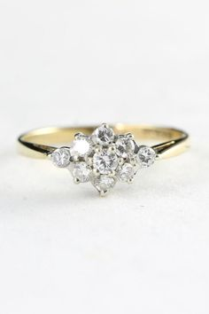 Half carat diamond cluster engagement ring in by aardvarkjewellery