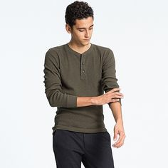 This men's long sleeve t-shirt is accented by a button-up Henley neck design…