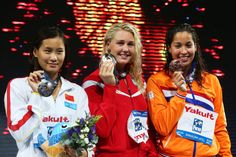 (L-R) Silver medal winner Ying Lu of China, Gold medal winner Jeanette Otteesn Gray of Denmark and Bronze medal winner Ranomi Kromowidjojo of the Netherlands celebrate on the podium after the Swimming Women's Butterfly 50m Final on day fifteen of the 15th FINA World Championships at Palau Sant Jordi on August 3, 2013 in Barcelona, Spain.