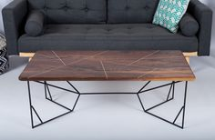"""New Design: Looking for something more than your usual coffee table? We have you covered! Stunning solid brass geometric inlays criss cross the surface of this solid walnut coffee table, perched atop a steel powder rod coated base. Available with matte black and matte white base only -1"""" Amish sourced FSC certified Black walnut tabletop. Available with our standard walnut, or heavily figured A++ walnut (additional charge) Dimensions: 46 x 20 x 16 or 46 x 24 x 16 Other dimensions available…"""
