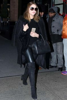 Ashley Benson wearing Saint Laurent Single Breasted Chesterfield Coat, Givenchy Small Antigona Bag, Stuart Weitzman Highland Boots, Prada Cat-Eye Double-Bridge Sunglasses and DL1961 Florence Instasculpt Skinny Leather Pants in Radar
