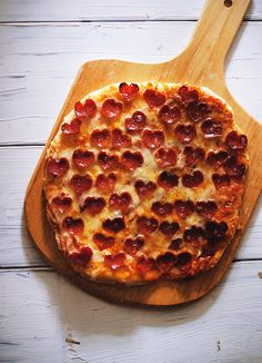 Love Pizza: Someone went through all that effort to cut all those little pepperonis into hearts . . . then made a round pizza?