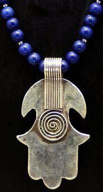 hamsa - handmade in Morocco - life spirals on reverse side - silver on lapis beads - beautiful. Hand Der Fatima, Beaded Beads, Moroccan Jewelry, Evil Eye Charm, Tribal Jewelry, Chunky Jewelry, Ancient Symbols, Hamsa Hand, Jewelery