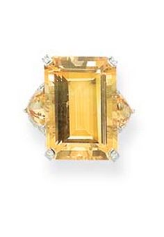 A CITRINE AND DIAMOND RING The rectangular-cut citrine between triangular citrine shoulders with diamond detail to the plain 18k white gold hoop, ring size 6¼, with cream pouch Stamped MdV for Michele della Valle