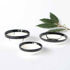 Trio set of three.One large,one medium and one small resin salt pepper spice pinch trinket dish bowls in black and white.