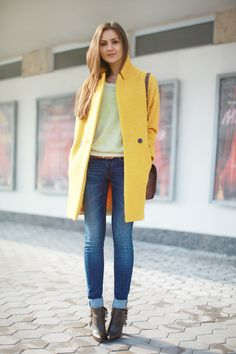 yellow coat with brown accessories + washed roll-up jeans + light knit sweater
