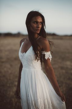 Boho lace cold shoulder wedding dress by Rue De Seine | Image by Eric Ronald Photography