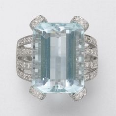 18KT White Gold, Aquamarine & Diamond Ring.