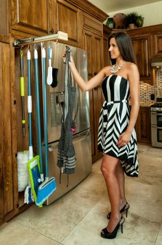 I like this idea for not only brooms but in the other side put apron and also spice rack!!!