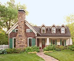 AFTER: A Revamped Cottage with Appeal  More windows -- some small, some tall -- break up both sections of the new facade. A new fireplace ma...