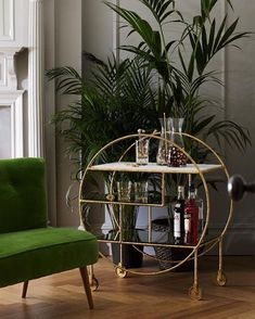 You just can't beat a gold bar cart. And with the green so sophisticated. barstoolsfurniture #70sglam #goldlux #gold #thursday #thursdayinspiration #midcenturymodern #midcentury #midcenturyliving #midcenturystyling #interiordesign #interiors #interiorstyle #interiorstyling #interiorinspo #homedecor #homestyle #homedesign #homestyling #interiorsblogger #interiorsblog #homeblog #homeblogger #inspo #interier #myhomevibe #styleithappy #2018interiors #2018style