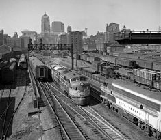 New York Central and Rock Island passenger trains meet just south of Chicago's LaSalle Street Station on August 21, 1950. Photograph by Wallace W. Abbey, © 2015, Center for Railroad Photography and Art. [2048x1785] : TrainPorn