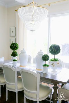 spring table preserved boxwood topiaries #topiary #topiaries #springdecor #diningroom #tablescape #springtablescape #dining #kitchentable #spring #whitegingerjar #boxwood #boxwoodtopiary