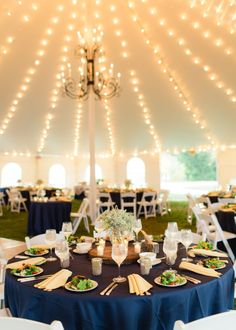 Oatlands Historic House & Gardens- Front lawn tented reception; royal blue linens; string lights; tree cookie; preset salad; RSVP Catering; Twin Brook Florist; Tenting by Capital Party Rentals; Marta Locklear Photography.