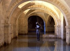 thevioletgarland:  This is the statue I mentioned in the Brit UPG cthonic post. It's by Anthony Gormley and stands in the partially flooded crypt of Winchester Cathedral. If this isn't an entrance to the Underworld I don't know what is. (Image source)