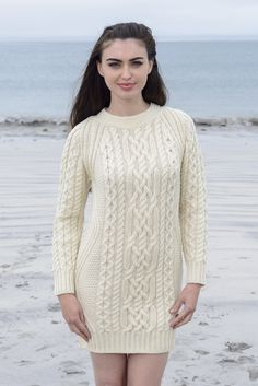 Aran Long Wool Tunic with Zig Zag Stitch  This chunky Aran Wool Sweater Dress, featuring the traditional zig zag as well as honeycomb and cable design, is the perfect solution to this year's sweater dress trend. Great styled alone as a dress or paired with leggings or skinny jeans, it works best as a stylish statement piece whilst providing warmth and comfort to the wearer.