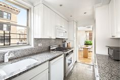 Using the same material for the backsplash and counter. Smart and wipe-able.