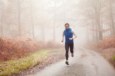 Man Running Along Countryside Road In Fog High-Res Stock Photography | Getty Images | 136645153