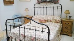 Double Victorian Bedstead with new coil mattress (still in cover)