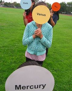 Set Up a Solar System of Kids Activity-- Students use steps to show the distances between planets!! How fun!