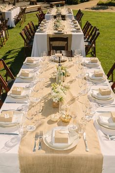 Love the table cloth with burlap. Also love center piece made out of wine crate. Great for Napa Wedding!!