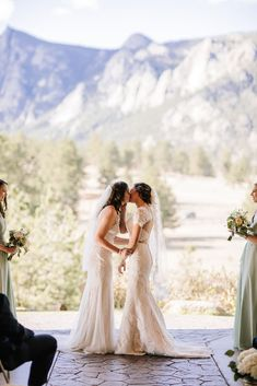 Rustic mountain wedding in the Colorado Rocky Mountains two brides lace white dresses veils kiss