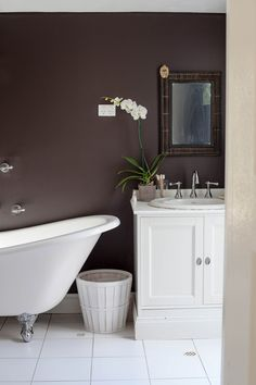 This white clawfoot tub stands out against the brown wall, making a huge visual statement in this Australian home. See the full home tour here at Sneak Peek: Annabelle Kerslake of Fête Magazine. #sneakpeek