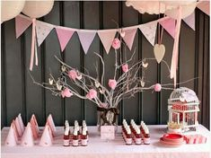 Love the tree branch centerpiece and bird cage